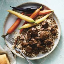 Beef Tips with Gravy, Basmati Rice, Baby Carrots, & Dinner Rolls